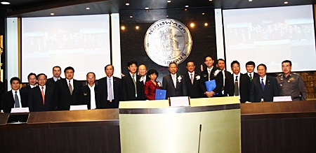 City and national officials pose for a commemorative photo after signing a memorandum of understanding for an automated traffic control system.