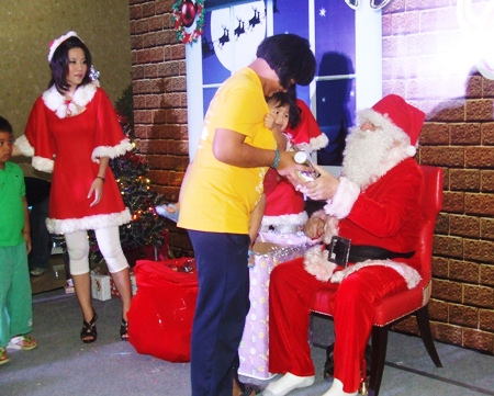 Don't be scared, Santa Claus wants to give you a present.