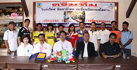 Pattaya mayor Ittipol Khunploem, seated center, and members of the Windsurf Association of Thailand, welcome back the successful sailors from the 2010 Asian Beach Games in Singapore.