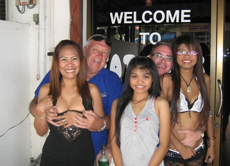 JJ, 2nd left and Andy Oz, 2nd right, with some of the staff at Mama's Bar
