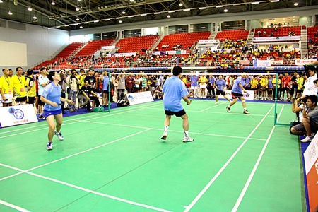 Badminton players take part in the 17th World Chinese Badminton Championships at the Eastern National Sports Center in Pattaya on Friday, November 19.