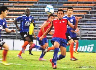 Pattaya United U-19's (red shirts) take on Thai Port Authority U-19's at the Pat Stadium in Bangkok on Thursday, Dec. 2.