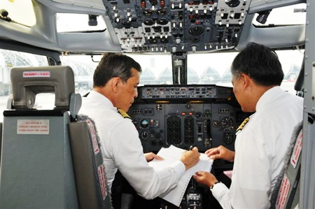 His Royal Highness Crown Prince Maha Vajiralongkorn goes through pre-flight preparations before takeoff.