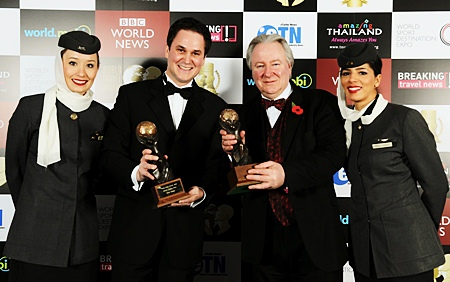 "Peter Baumgartner (left), Etihad's chief commercial officer, celebrates winning the title for ""World's Leading Airline"" and ""World's Leading First Class"" airline at the World Travel Awards, with Graham Cooke (right), president and founder, World Travel Awards, and Etihad cabin crew members."