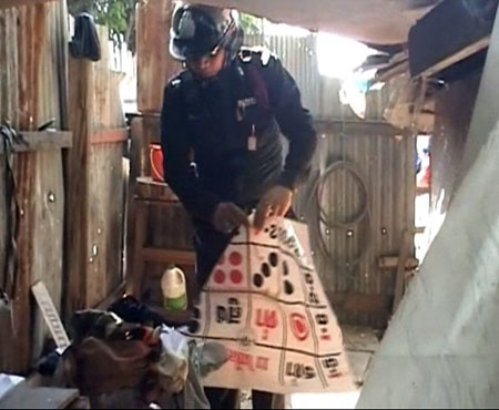 Police Descend on Gambling Den