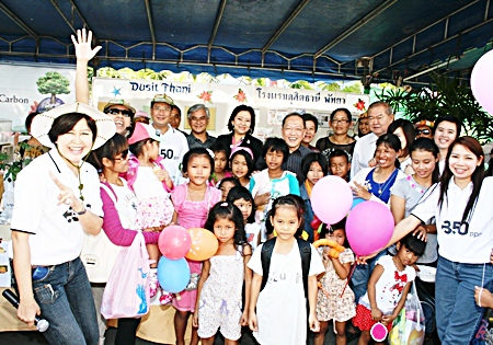 Chatchawal Supachayanont (centre), GM of the Dusit Thani Pattaya and his management team joined other hotels and establishments in Pattaya to celebrate National Children's Day on January 8 at City Hall. Hundreds of happy children and their families were treated to the mouth-watering Dusit ice cream and assortment of sweets. The big kids joined the little ones in games that taught the children to be friendly to the environment and how to lead a healthy life in conjunction with the theme, '350 ppm'.