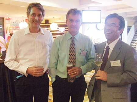 Sutlet Group's Richard Prouse shares a glass with Paul Flipse and Yasuhide Fujii of KPMG.