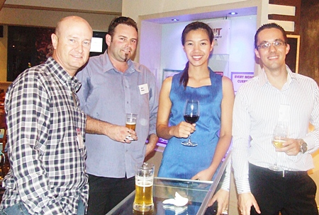 Neil Farrell and Wayne Meaclem of Elastomer Products (Thailand) Ltd. enjoy a drink with the Hilton Pattaya Hotel's Panicha Thananaken and Elwin Kemmimg.