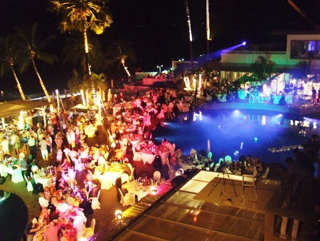Hundreds of guests gather around the pool to ring in the New Year at Pullman Pattaya Aisawan Resort & Spa.