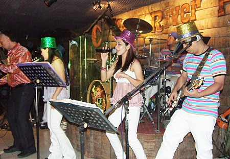 As the magic hour approaches, and well beyond, the house band at the Moon River Pub cranks up the volume and inspires guests to dance into the New Year.