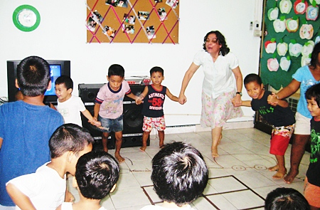 Teacher Margaret joins with the fun at the Hand to Hand center.