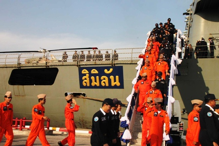 Officers and crew members disembark HTMS Similan at Juksamet port following a four month mission at sea to protect Thai merchant vessels against piracy.