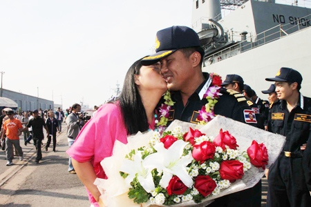 Above and below: Despite mixed fortunes at sea, the crew of the two vessels were guaranteed a warm welcome home from loved ones.