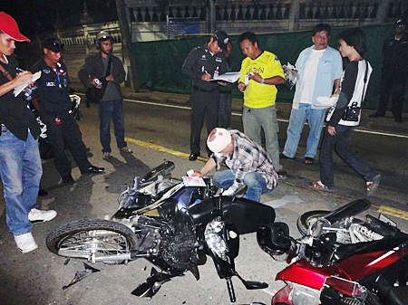 German Quarz Gunter retrieves paperwork from his demolished motorcycle after the fatal crash.