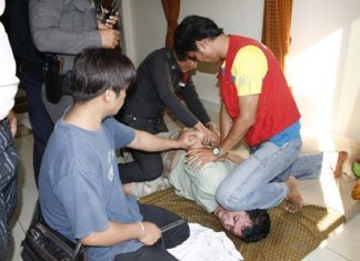 Police and friends bring the Turkish mugger under control inside the massage parlor.