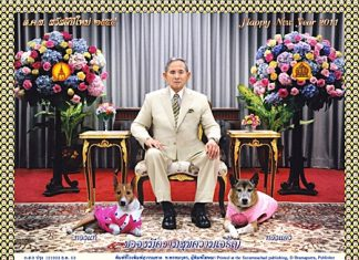 His Majesty the King, shown here with his dogs, Tongdaeng on his left and Tongthae on his right - says we all have the same New Year's wish - to be happy and to progress in life.