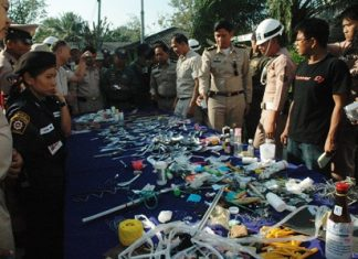 Officials gather around some of the illegal contraband confiscated during the pre-New Year sweep.