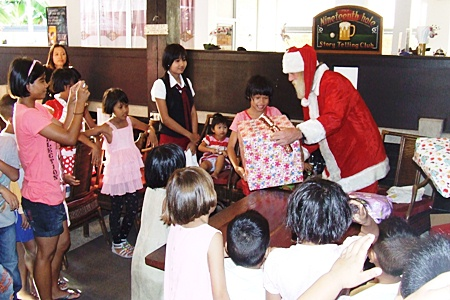 Jolly Ol' St. Nick hands out gifts to the excited Ban Jing Jai residents.