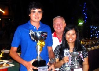 Men's and Ladies Annual Club Champions, Patrick Kelly, left, and Ngamjit Emmerson, right, hold their trophies while the PSC Golf Chairman Joe Mooneyham stands center rear.