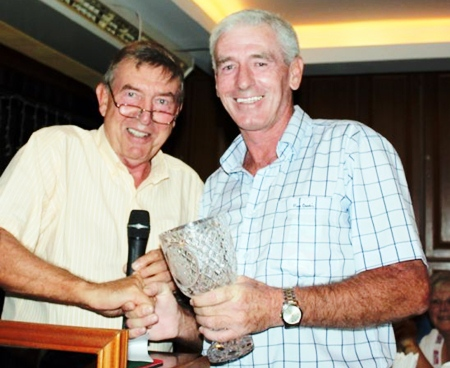 President's Day runner-up Seamus Cotter, right, accepts his prize.