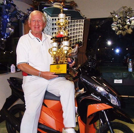 Jan Johansson poses with the series trophy and his gleaming new Honda Click motorcycle.