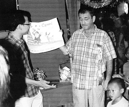 """Chris """"Quinny"""" Quinn (right) with Father Peter at the Christmas Day Camel Bar lunch for the children of the Camillian Centre in Rayong."""