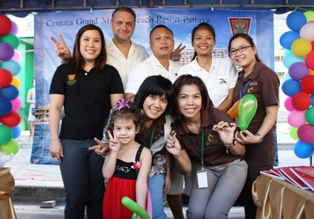 Mario Beyer (2nd left), executive assistant manager of the Rooms Division for Centara Grand Mirage Beach Resort Pattaya, along with hotel staff participated in the Children's Day activities at Pattaya City Hall. Children enjoyed games organized by the staff who also distributed gifts and sweets to the children.