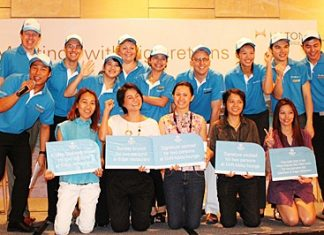 Winners of the lucky draw celebrate their winnings with Hilton Pattaya management and staff.