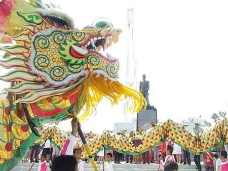 Dragon dancers perform at the Prince Chumporn Khet Udomsak Monument on Pratamnak Hill.