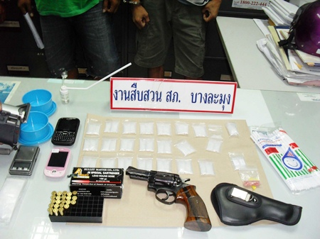 Police confiscated drugs, phones and weapons in the sweep of Rongpo neighborhood.