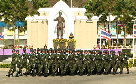 Soldiers parade past the King Naresuan monument in Chonburi.