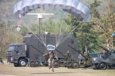 A paratrooper lands on the parade grounds in Sattahip.