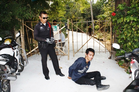 Police have Jirayu Luangsakda under control at the scene of the shootout.