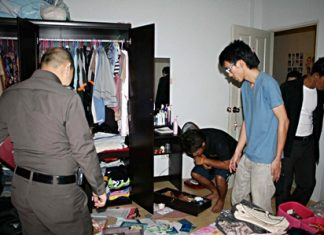 Police look for clues at one of the burgled houses.