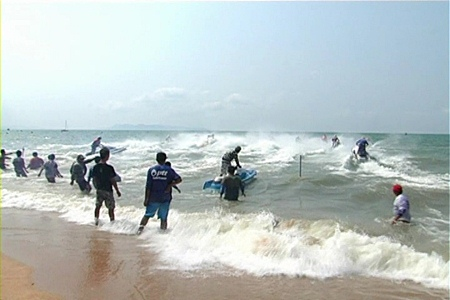 Jetski riders crash through the surf at the start of one of the races on Saturday.