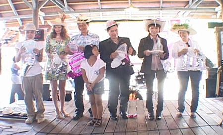 Dignitaries take to the stage to announce the distribution of free condoms to Valentine shoppers at the Pattaya Floating Market.