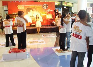 The kissing couple attempt to smooch their way into the record books at the Royal Garden Plaza in Pattaya, Feb. 14.