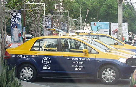 Metered taxis line up to wait for customers.
