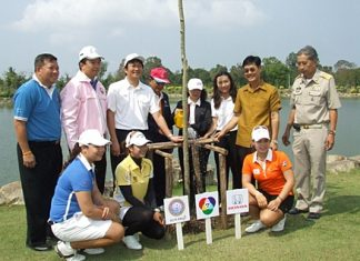 Golfers, sponsors and promoters pose for a commemorative photo during the tree planting event.