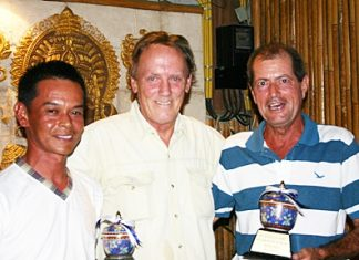"Club Captain David Thomas (center) presents the PGS 'Player of the Year 2010'"" awards to Wichai Tananusorn (runner-up) and winner Tony Thorne."