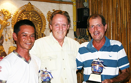 """Club Captain David Thomas (center) presents the PGS 'Player of the Year 2010'"""" awards to Wichai Tananusorn (runner-up) and winner Tony Thorne."""