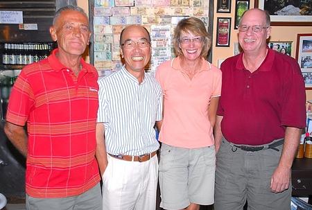 Flight winners Mashi Kaneta and Carole Kubicki, center, with Brian Gabe and Jack Robertson.