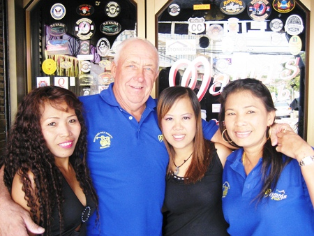 JJ, 2nd left, celebrates his golfing success with the staff at Mama's Bar.