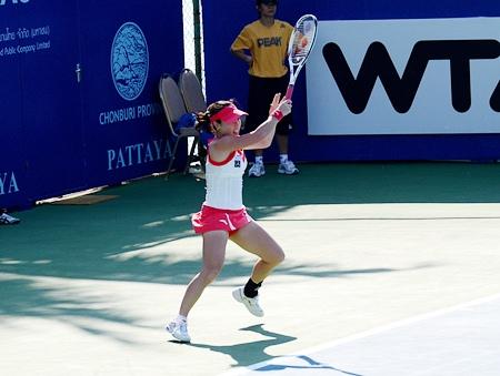 China's Jie Zheng returns the ball during her opening match.