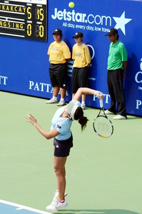 Tanaporn Thongsing of Thailand serves during her qualifying match against Turkey's Cagla Buyukakcay on Sunday.