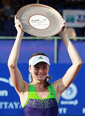 Daniela Hantuchova of Slovakia holds the trophy after winning her final match over Sara Errani of Italy in the PTT Pattaya Open tennis tournament in Pattaya, Sunday, Feb. 13. (AP Photo/Apichart Weerawong)