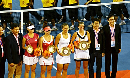 The doubles champions and runners-up pose with their trophies.