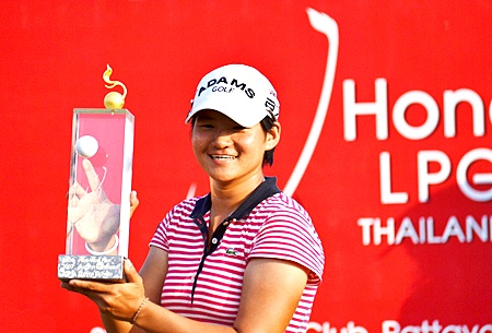 Yani Tseng of Taiwan holds up the 2011 Honda LPGA Thailand champion's trophy after shooting a final round 66 to win the tournament by 5 shots on Sunday, Feb. 20.