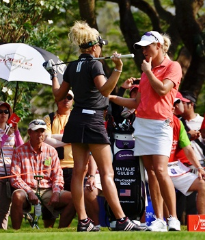 The colorful Natalie Gulbis, left, and the 2007 Honda LPGA Thailand champion, Suzann Petterson, right, wait to tee-off on the final hole.