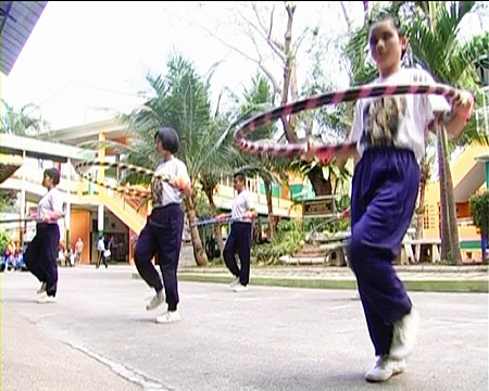 Young students from the Redemptorist School take part in the hula-hoop competition.